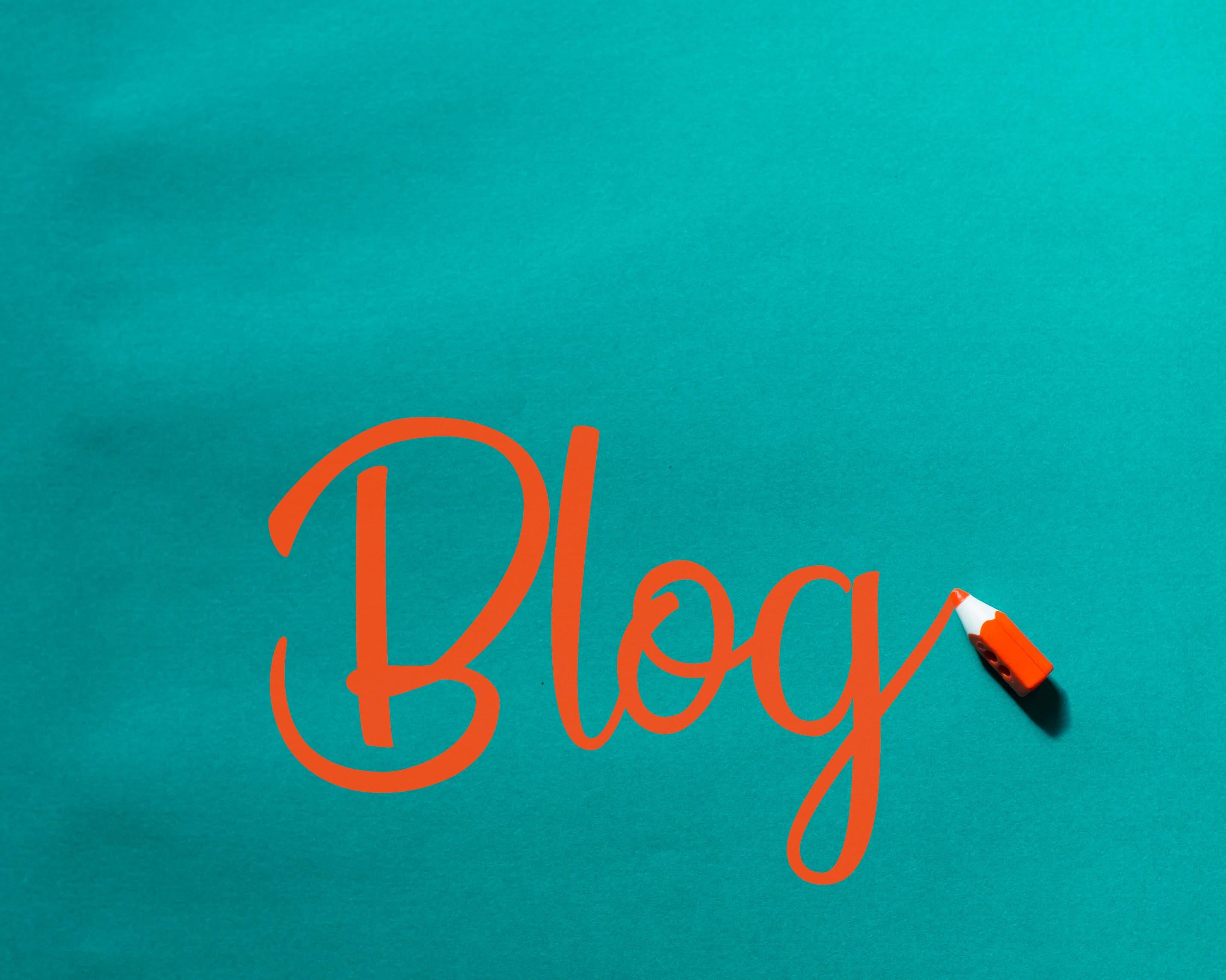 Blue background with ''Blog' written in orange
