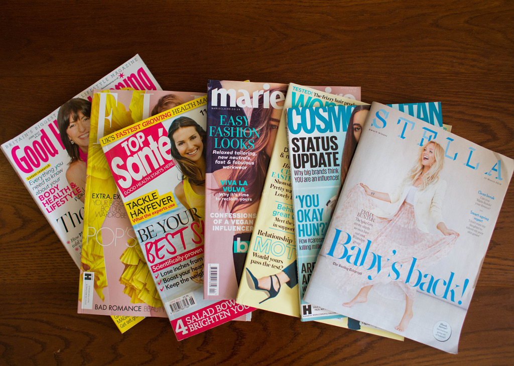 Women's magazines spread out on coffee table