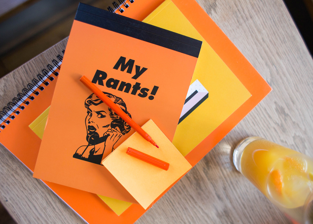 Stack of orange and yellow stationery with 'My rants' on top