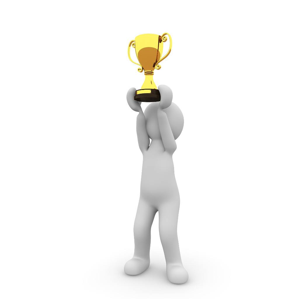 White plasticine character holding up a gold business award trophy