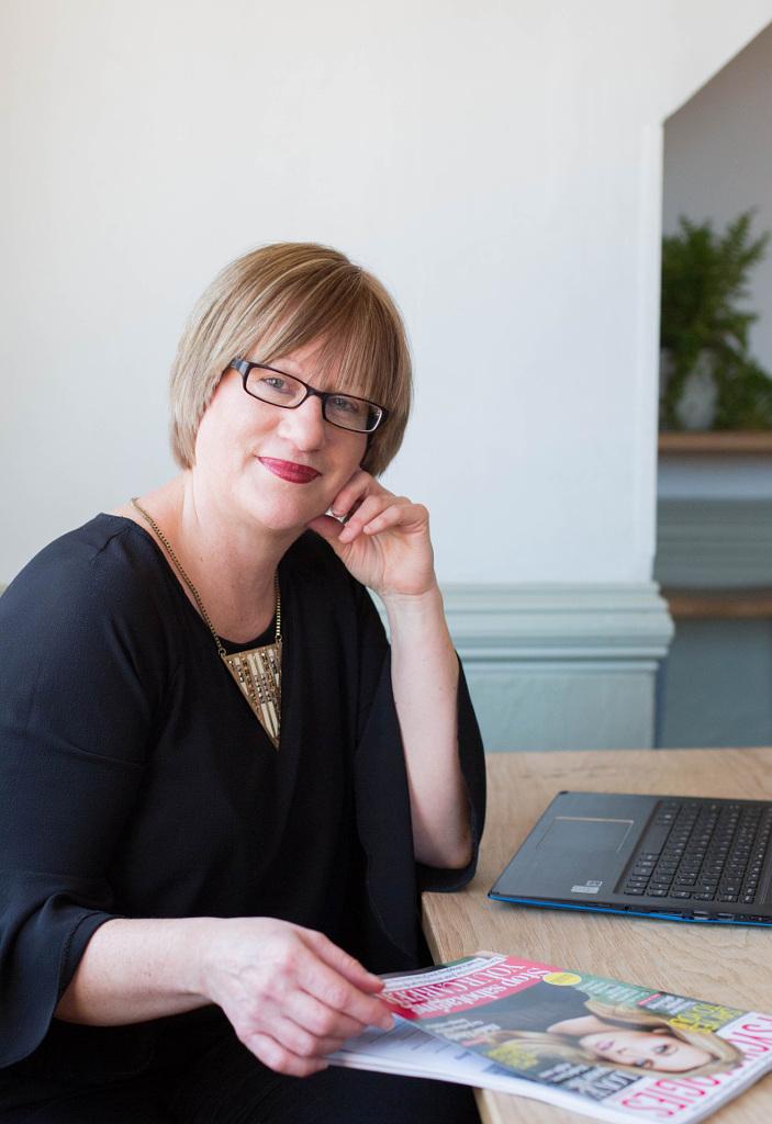 Media consultant Helen Gent with women's magazine on desk