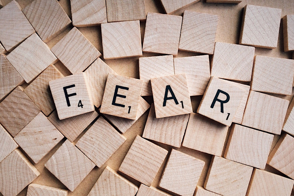 The word 'Fear' spelt out in Scrabble letters