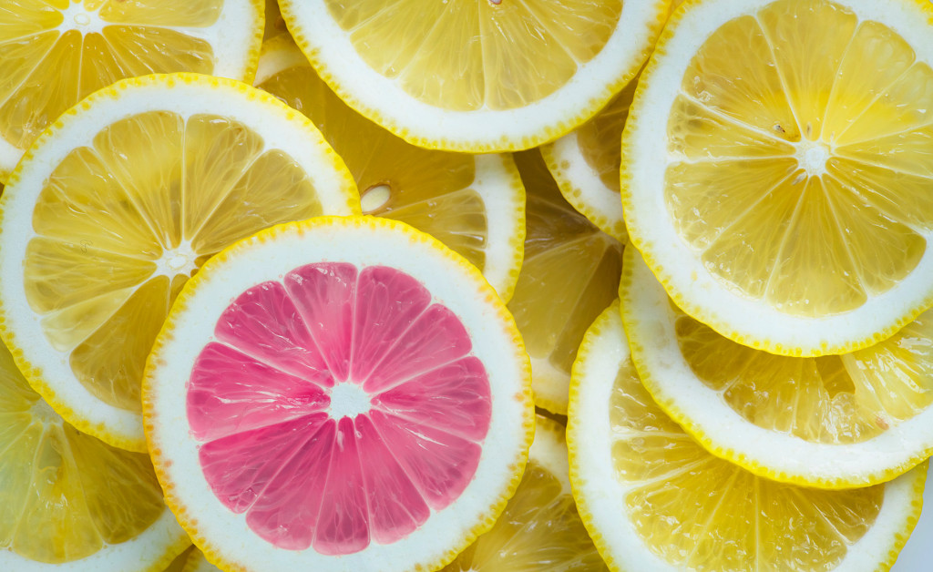 Slices of lemon with one slice of pink lemon