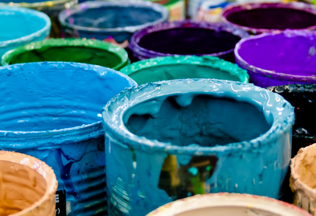 Tins of coloured paint